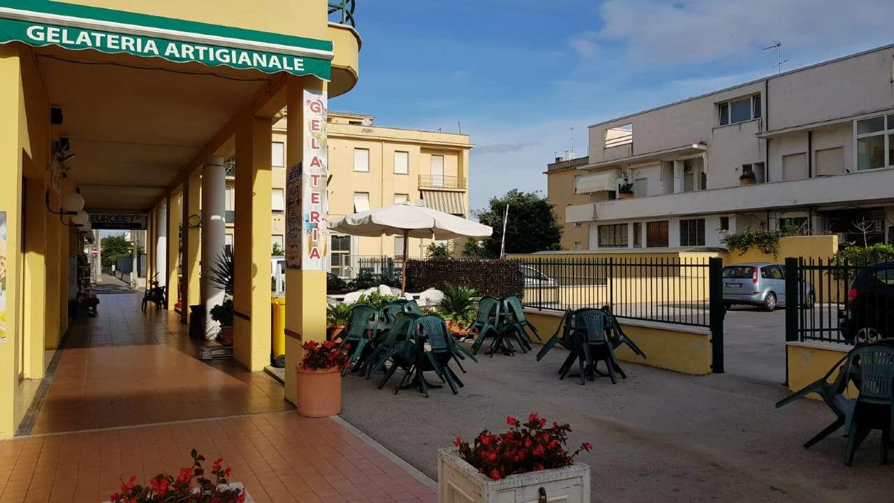 Negozio in zona centrale con portico e posto auto Rif. 8288858