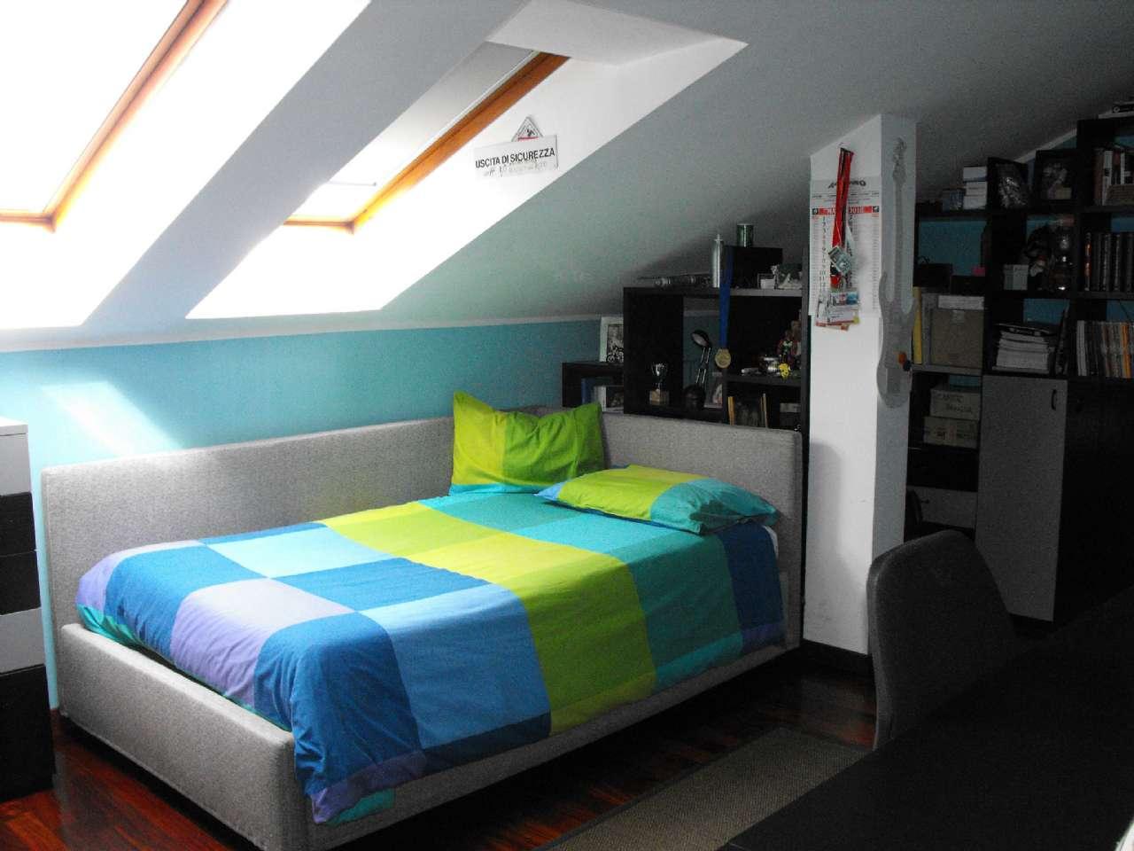 Ampio appartamento su due livelli con terrazzino, box e cantina, foto 12