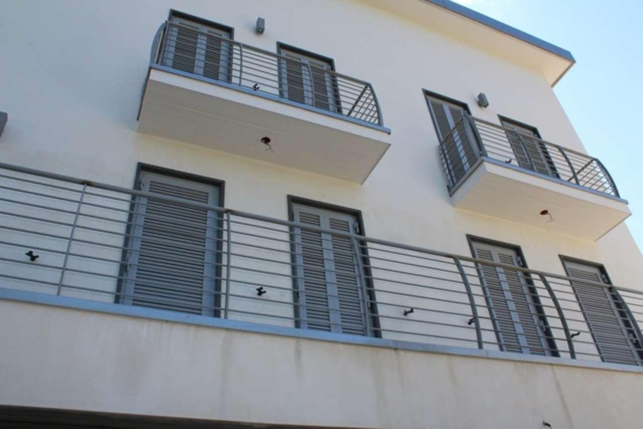 Bilocale di nuova costruzione con terrazzi, cantina e garage