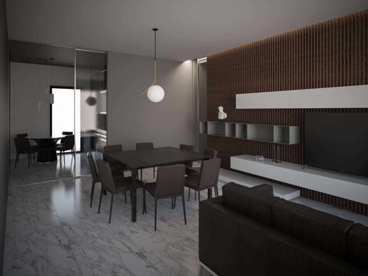 Ampio appartamento di nuova costruzione con giardino e box